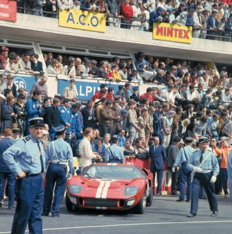 24 Hours of LeMans, LeMans, France, 1966. Dan Gurney prepares to start the race as the record setting crowd watches. CD#0777-3292-0624-1.