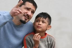 dad talking with boy