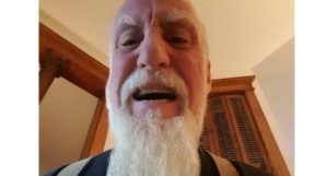 mitch rezman with long white beard looking very angry