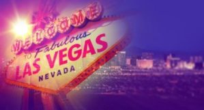 Las Vegas sign super imposed against Las Vega nevada