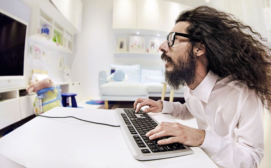 Computer specialist working in a bright office