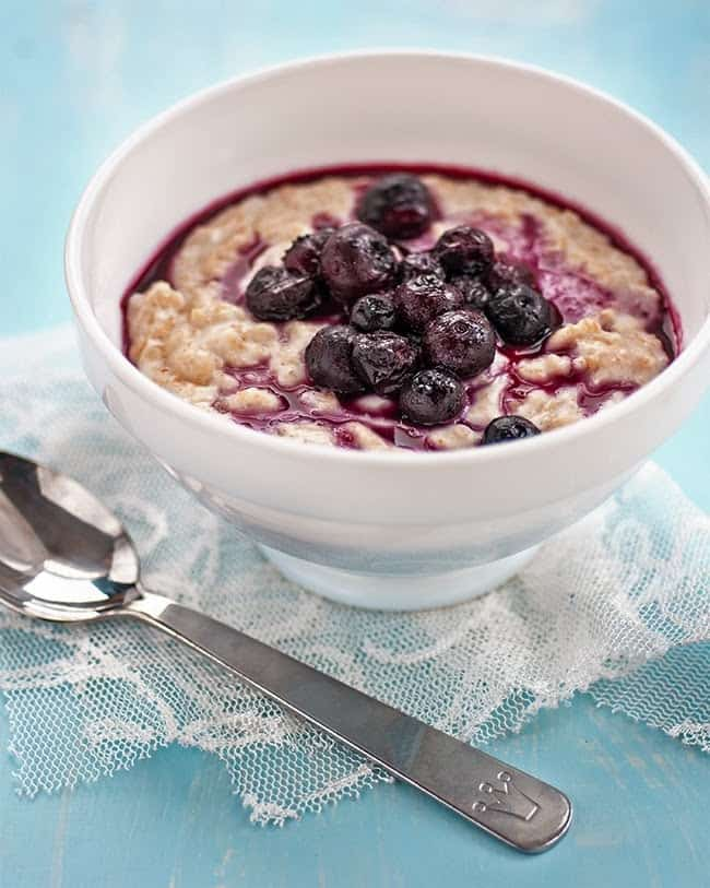 This simple vegan coconut oatmeal (porridge) with blueberry compote is as delicious as it is healthy. An excellent way to start your day!