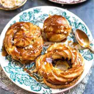 Choux filled with chocolate ganache and drizzled with salted caramel – a wonderful dessert that will make chocoholics drool.