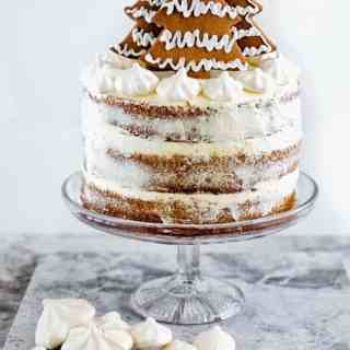 Gingerbread layer cake with cinnamon cream cheese frosting and gingerbread Christmas tree decoration