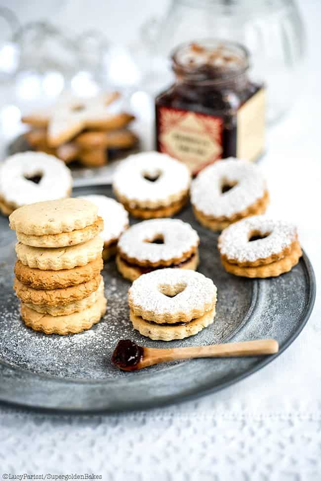 Spiced Almond and Cardamom Linzer Cookies with Blackberry and Apple Jam