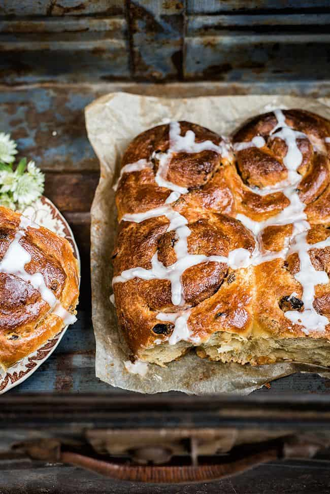 Pillowy soft, studded with raisins and fragrant with spices these irresistible hot cross cinnamon buns are simply perfect for Easter!