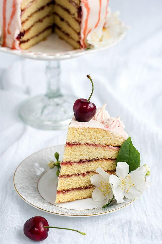 Vanilla layer cake with cherry berry jam and vanilla bean buttercream | Supergolden Bakes