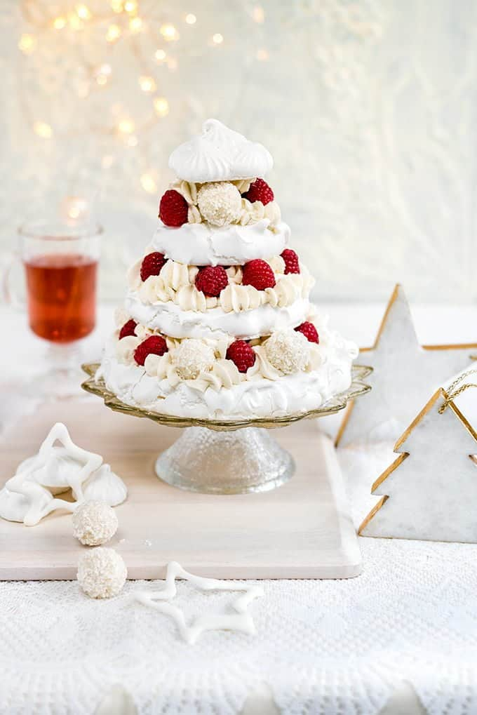 Meringue Christmas tree with whipped coconut cream, raspberries and white chocolate truffles