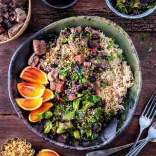 One-pot Brazilian feijoada – rich pork stew with black beans served with spring greens and rice