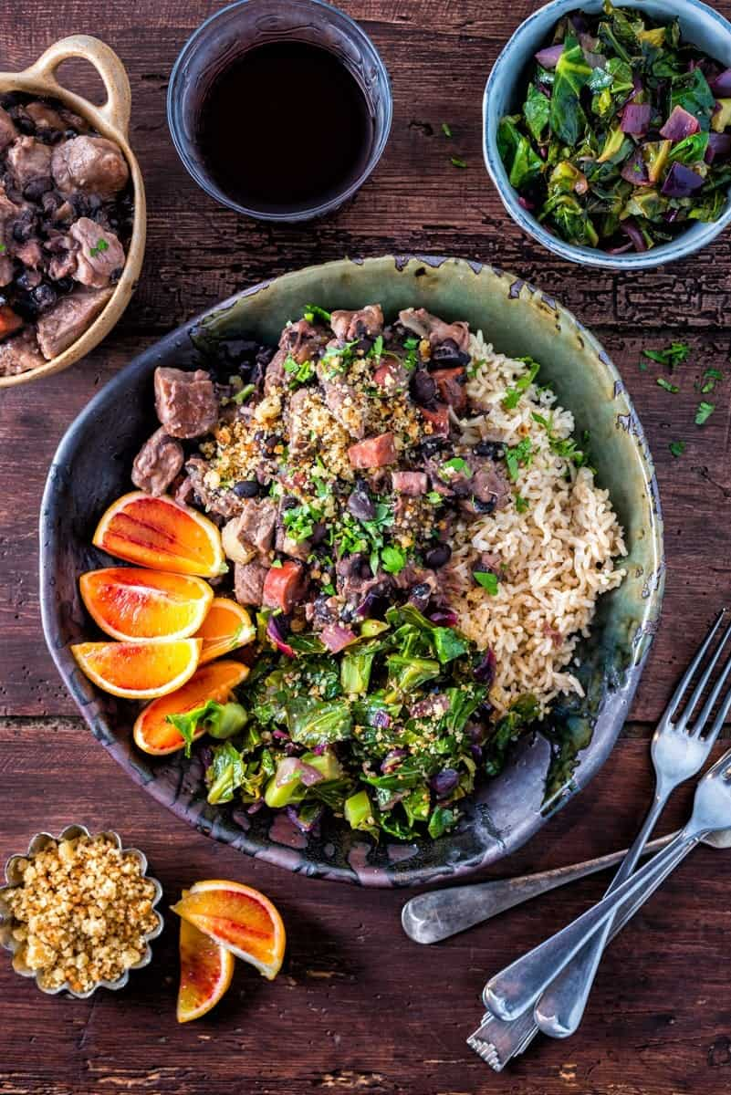 Slow cooker Brazilian feijoada – rich pork stew with black beans served with spring greens and rice