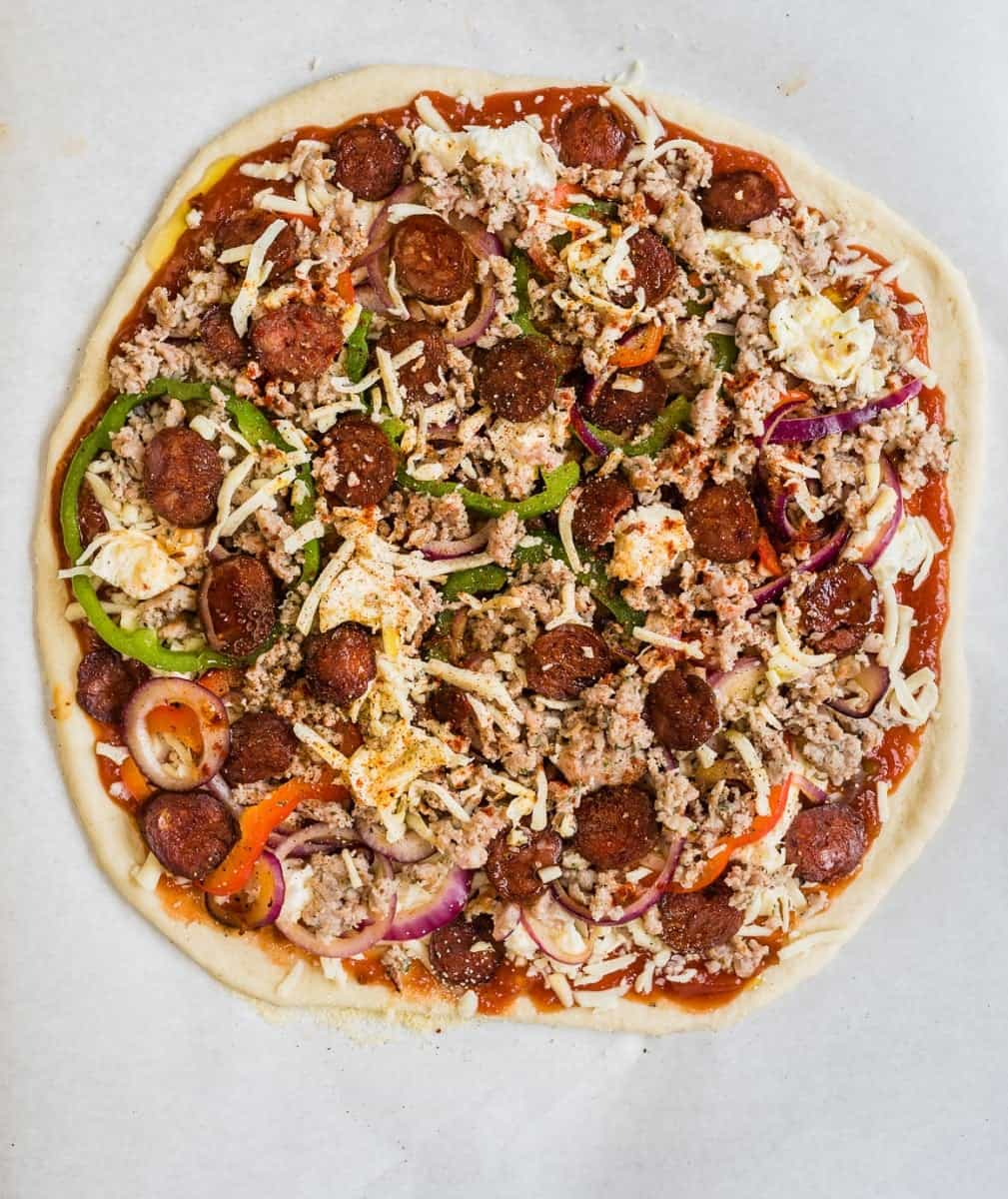 Fully-loaded spicy sausage and pepper pizza - with a salsa base, two types of mozarella, sausage, spicy smoked chorizo, onions and peppers