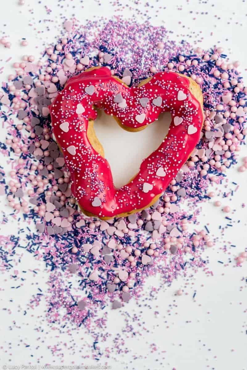 Surprise your Valentine with these delicious heart-shaped chocolate eclairs with vibrant berry glaze and fairy sprinkles!