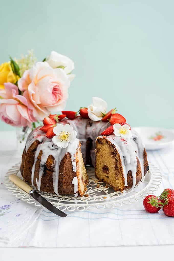 This gorgeous strawberry and rose scented bundt cake is dotted with fresh strawberries and covered with a simple lemon glaze.