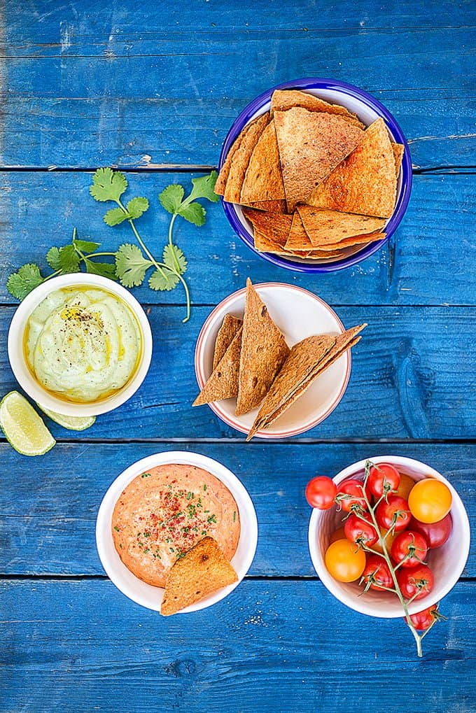 Make sure you keep your guests and family happy while the barbecue is heating up by serving up these two super-easy essential summer dips.