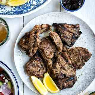 Make the famous Greek grilled lamb chops (paidakia) at home on your barbecue using this simple but delicious marinade. Serve with my mum's addictive potato salad!