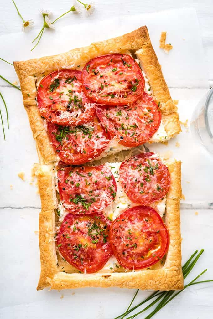 These super-easy vegetarian puff pastry tomato tarts with feta and ricotta make an excellent starter or light summer lunch.