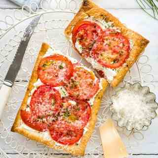 Easy puff pastry tomato tarts with ricotta and feta. An excellent vegetarian starter or light lunch.