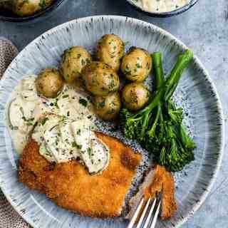 These pork schnitzel with creamy mushroom sauce cook in mere minutes and taste pretty sensational. Serve with boiled new potatoes or mash for the perfect midweek meal.