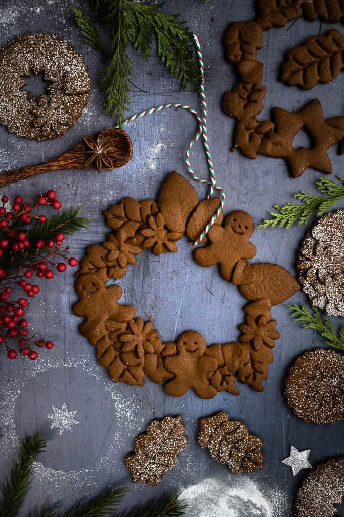 Vegan gingerbread cookie wreaths - dust with icing sugar for an extra sprinkle of festive magic