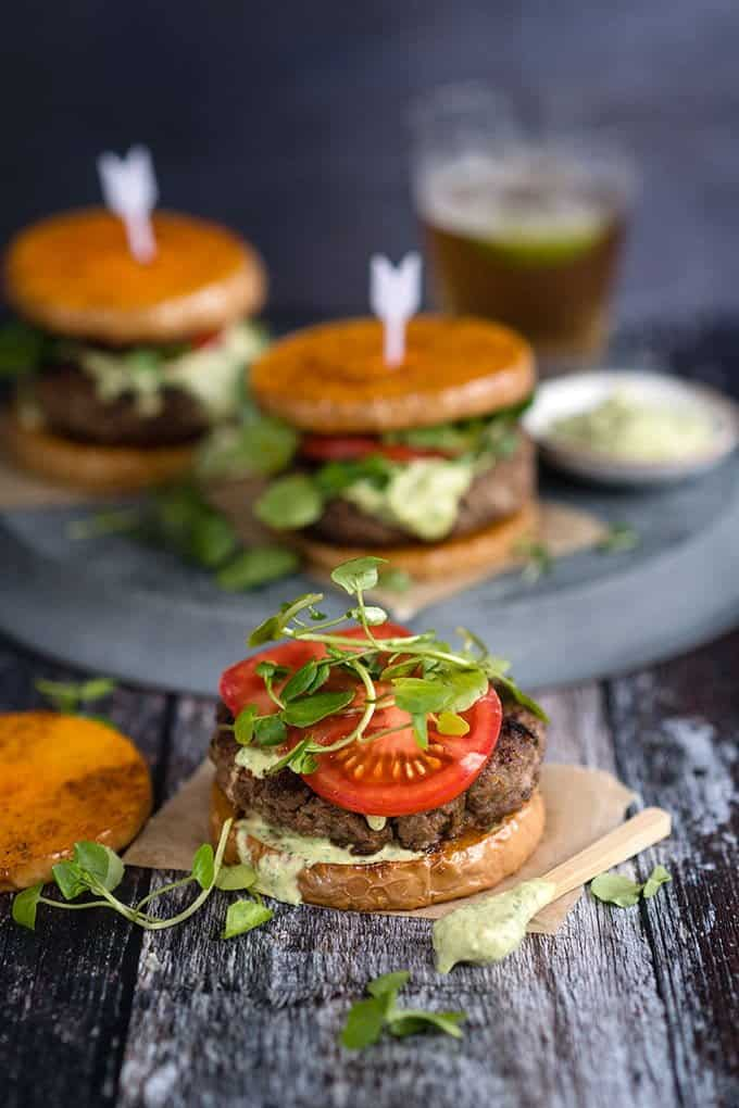 Use butternut squash slices instead of bread in these delicious Greek lamb burgers – a lower carb option that also eliminates the need for fries!