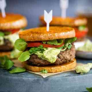 Greek lamb burgers with green tahini dressing on butternut squash buns with addictive green tahini dressing
