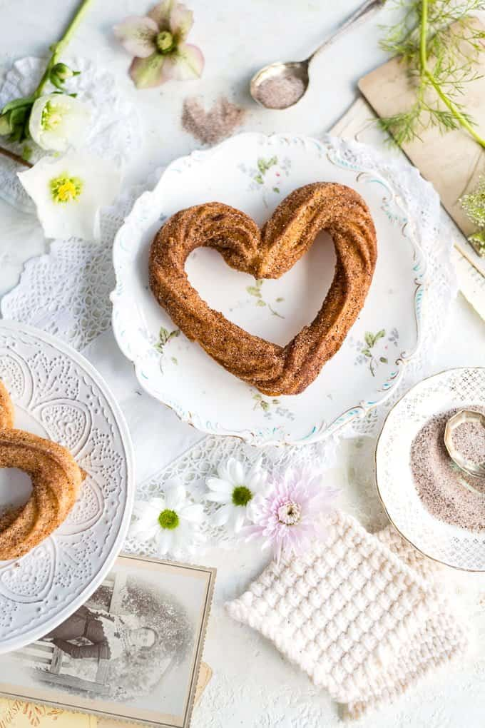 Heart-shaped churros on a plate shot from above