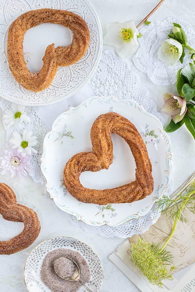 Heart-shaped vegan churros on pretty vintage plates