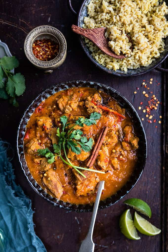 Bowl of lamb Dhansak curry with pilau rice on the side