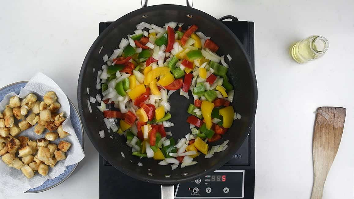 Stir frying onion and peppers