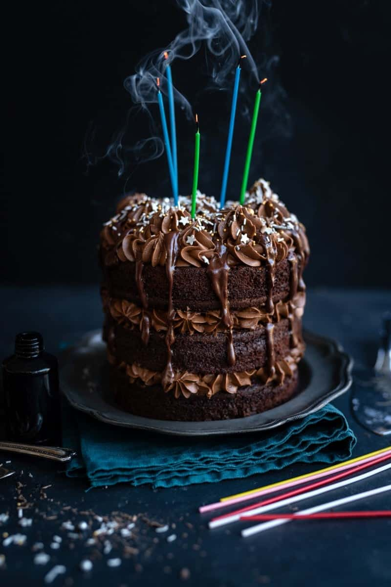 Candles blown out on chocolate birthday layer cake