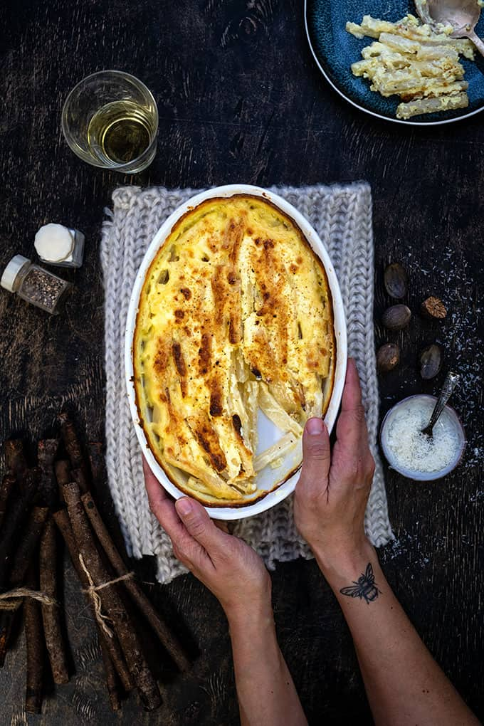 Root vegetable gratin in an oval dish shown overhead