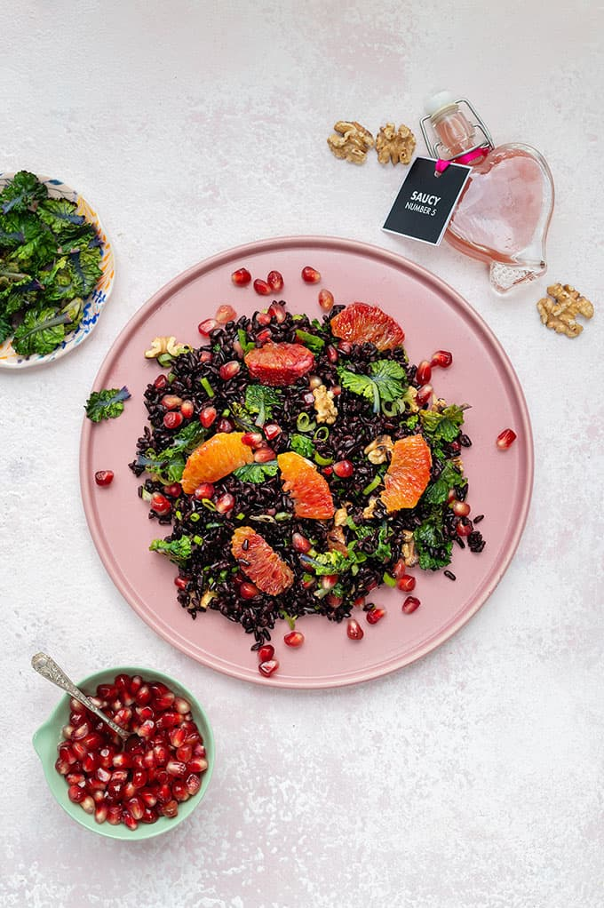 This delicious black rice salad with pomegranate, kale and blood orange pairs brilliantly with simple pan-fried salmon.