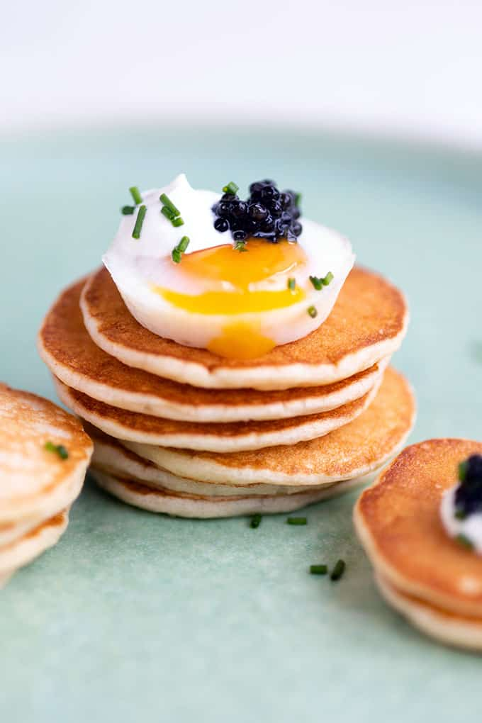 Stack of blini with egg and caviar