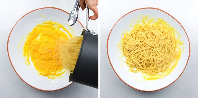Adding hot pasta to a bowl of whisked eggs and cheese to make carbonara