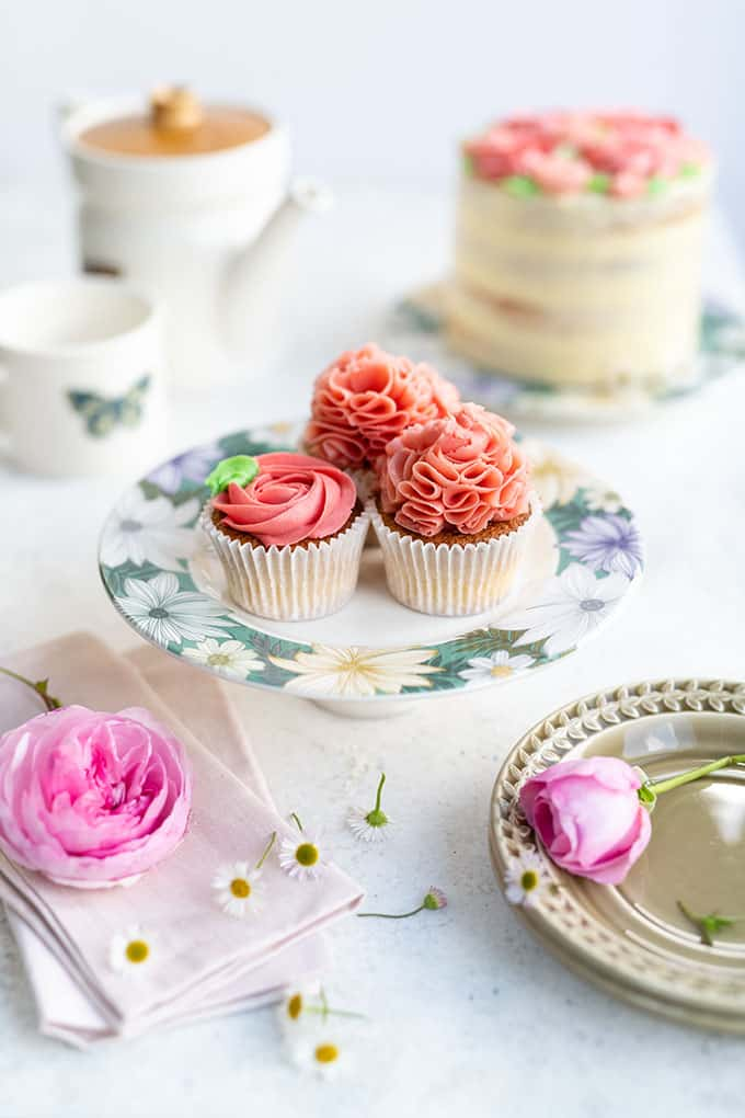 Cupcakes frosted with easiest Swiss buttercream on a cake stand