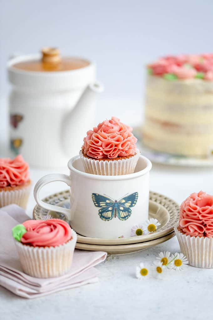 Pretty cupcake with ruffled buttercream frosting in teacup