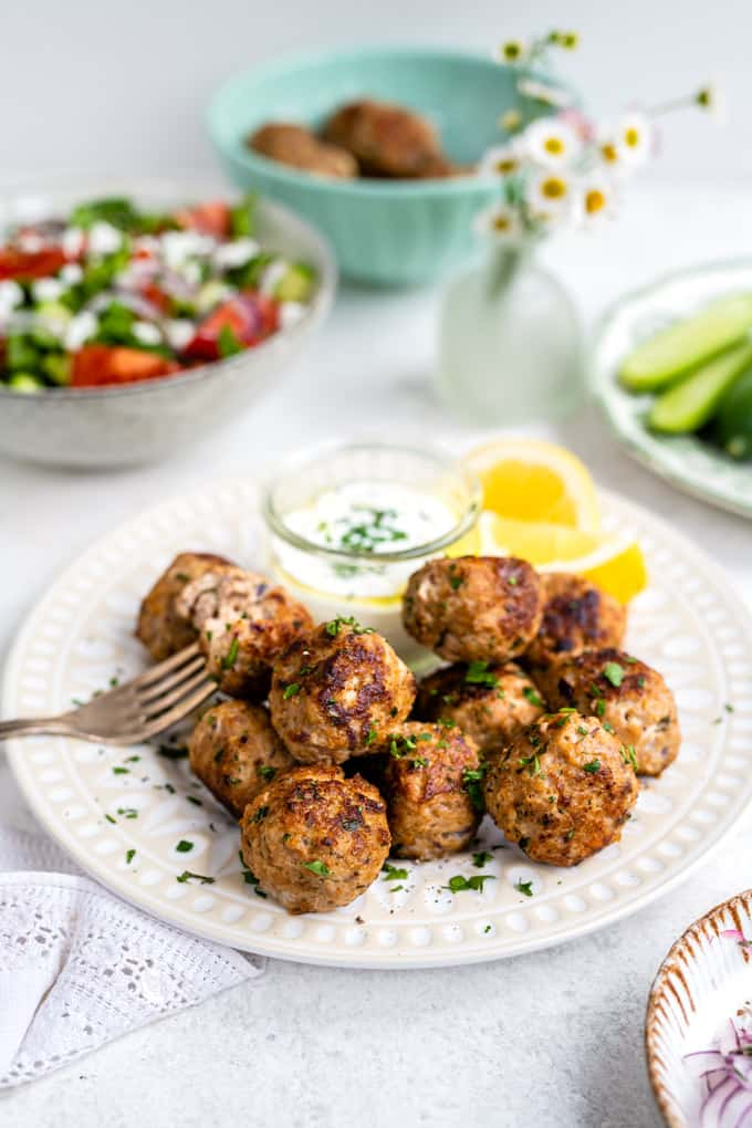 Plate of Greek meatballs (keftedes) served with Tzatziki and Greek salad