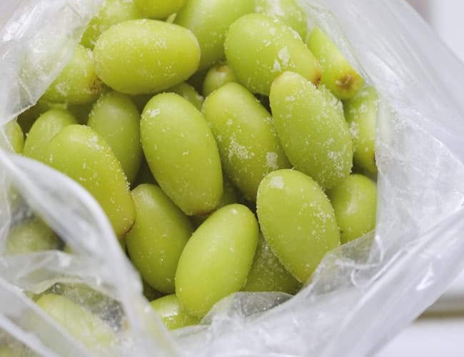 frozen green grapes in a bag