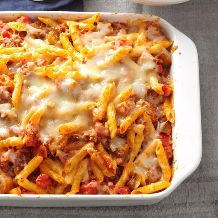 cheesy casserole featuring ziti and tomato sauce