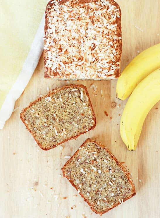 Overhead view of coconut banana bread with two slices