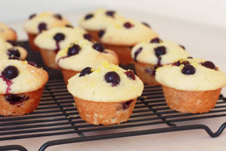 lemon blueberry muffins on a cooling wrack