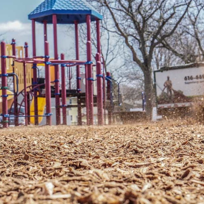 Covering playground with wood chips