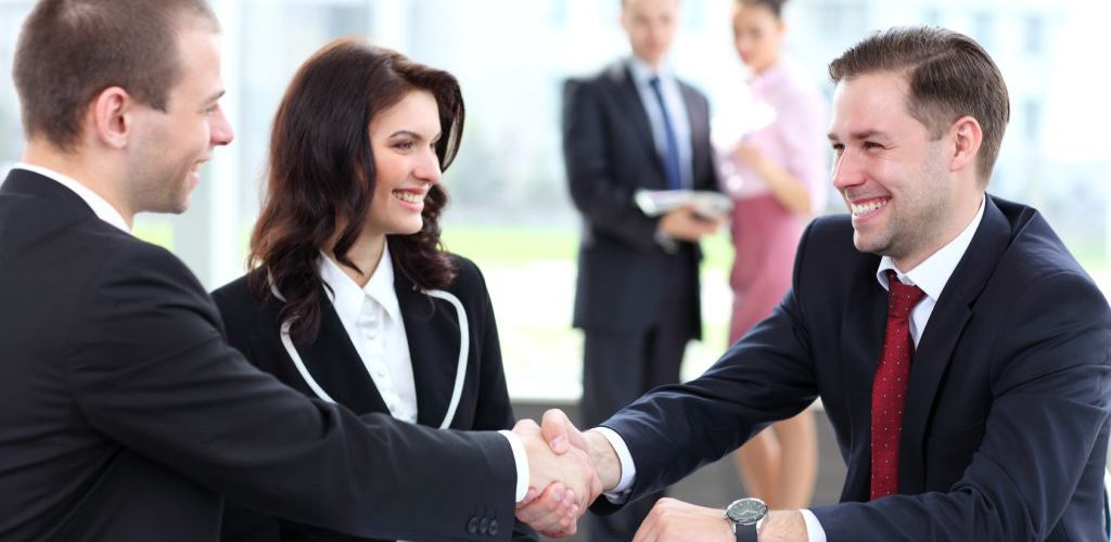 Business people shaking hands, finishing up a meeting
