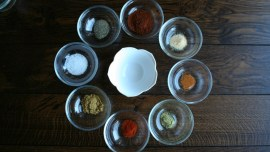 8 small bowls with the ingredients for Homemade Taco Seasoning