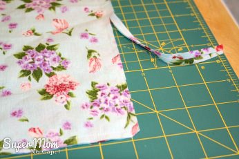 How to Sew A Basic Throw Pillow - Trim seams to one quarter inch and clip corners