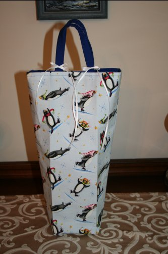 This one, I made taller with a squared off bottom. It will be perfect for a wine bottle or other similiarly sized gift.