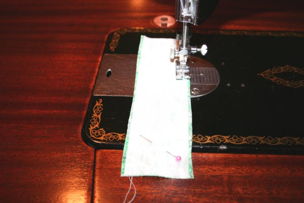 Stitch interfacing to wrong side of hanging loop
