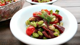 Beet and Edamame Salad single serving topped with a sprig of fresh dill weed
