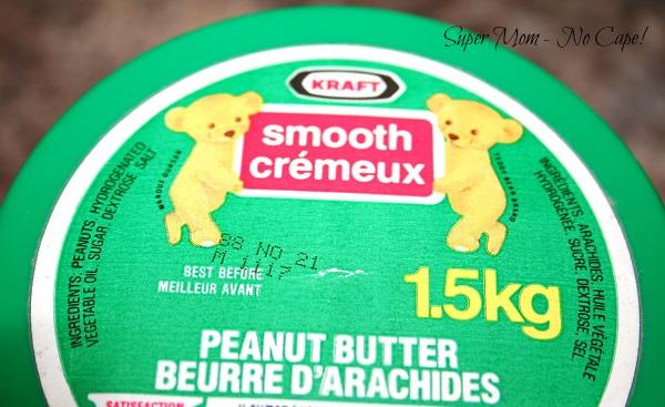 Lid of Vintage Glass Kraft Peanut Butter jar showing best before date