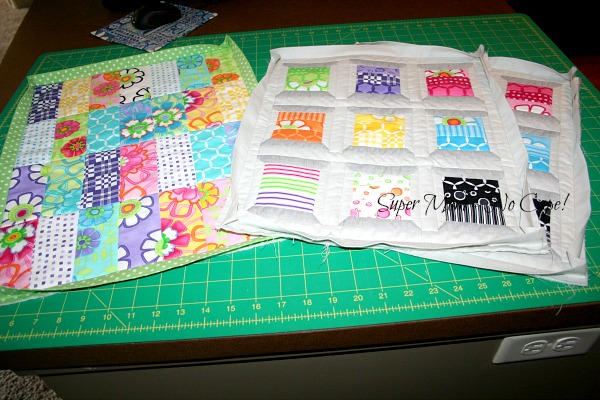 Three mini quilts with binding attached